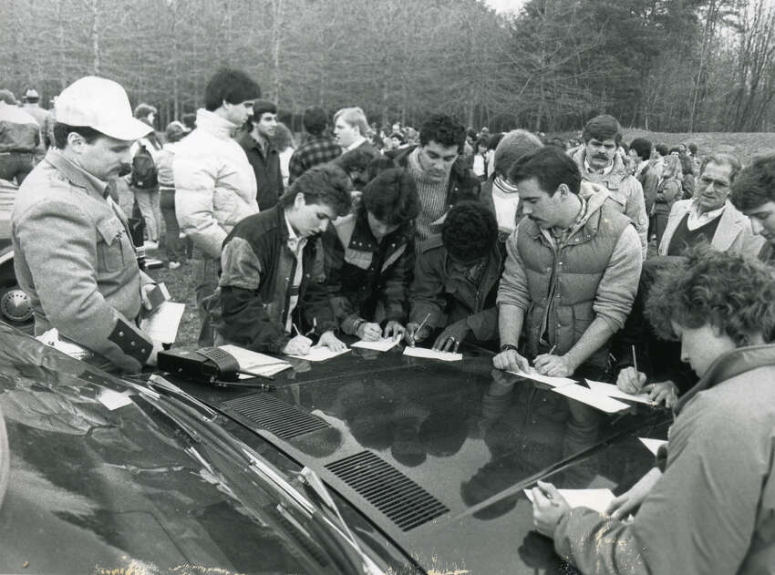 At left, Trooper Jeff Guildersleeve in the baseball cap prepares his group for the search for University at Albany student Karen Wilson on April 11, 1985. (Skip Dickstein/Times Union archive)
