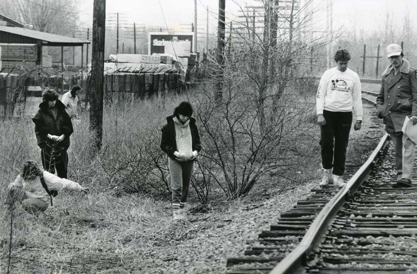 Trooper Ronald K. Wall of Troop E, right, and University at Albany students search along tracks just west of Fuller Road and south of Railroad Ave. April 11, 1985, in Colonie, N.Y. (Times Union archive)