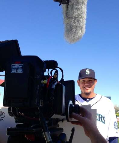 Mariners star Felix Hernandez gets ready for his close-up while shooting a TV commercial.