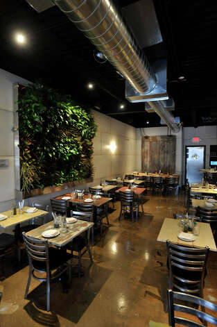 The interior of The Spread in Norwalk features a panel of vegetation. Photographed on Thursday, Feb. 7, 2013. Photo: Jason Rearick / The News-Times