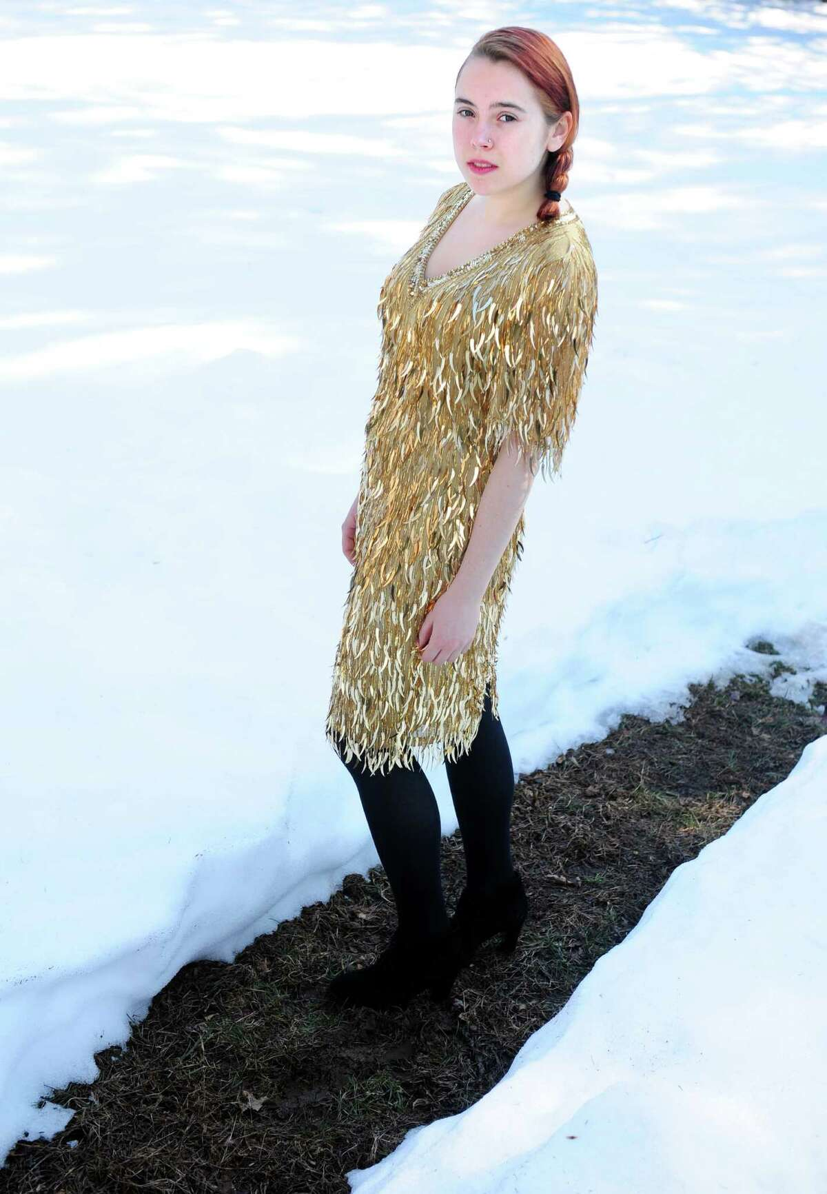 Juliana Gagne, 18, of Fairfield, at home in some of her favorite vintage finds. This fluttery gold, vintage dress she bought for $98 at The Label Exchange in Fairfield.