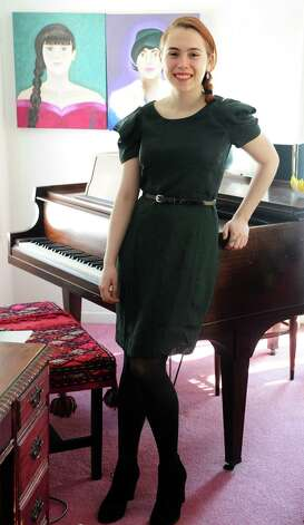Juliana Gagne, 18, of Fairfield, at home in some of her favorite vintage finds.  This green dress, originally from The Gap, Gagne bought at Twice Is Nice, a consignment shop in Fairfield, for $6. Photo: Autumn Driscoll