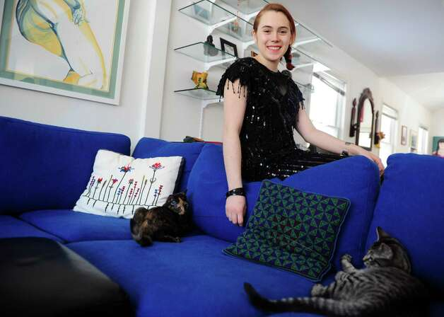 Juliana Gagne, 18, of Fairfield, at home in some of her favorite vintage finds.  This black sequined, vintage dress she bought for $48 at The Label Exchange in Fairfield. Photo: Autumn Driscoll
