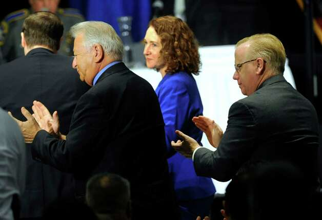 Danbury Mayor Mark Boughton, right, and Congresswoman Elizabeth Esty, join the applause for Newtown First Selectman Pat Llodra Thursday, Feb. 21, 2013. A conference on gun control was held at Western Connecticut State University on Thursday. Photo: Carol Kaliff / The News-Times