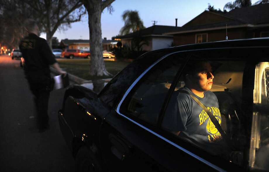 Alexander Hernandez is arrested after agents found a handgun in his possession - unlawfully, because of a domestic violence restraining order. Photo: Wally Skalij, McClatchy-Tribune News Service