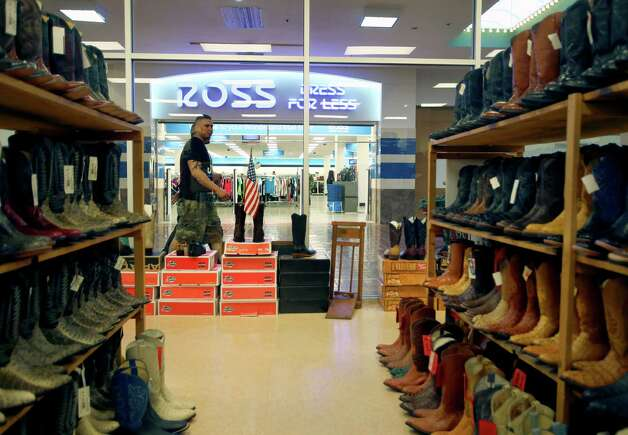 The Ross store in The Wonderland of the Americas mall is seen Wednesday Feb. 20, 2013, though the boots and window displays of new mall tenant Cowtown Boots. Photo: William Luther, San Antonio Express-News / © 2013 San Antonio Express-News
