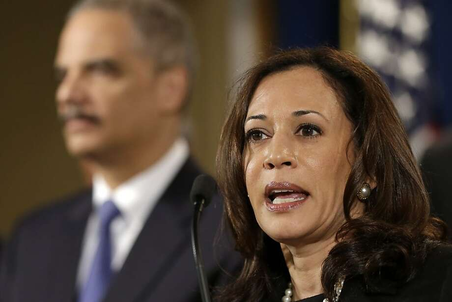 California Attorney General Kamala Harris, here with U.S. Attorney General Eric Holder, was a lead negotiator on the mortgage settlement with the five banks. Photo: Jacquelyn Martin, Associated Press