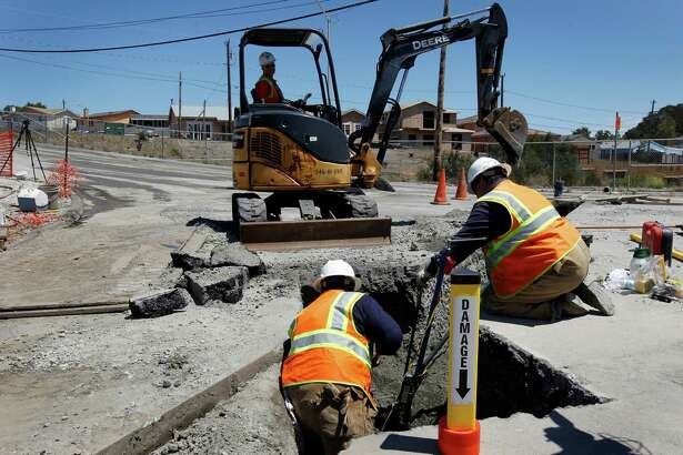 A PG&E crew replaces a 2-inch gas line in San Bruno after it was punctured by an independent contractor in 2012 digging at the exact location of the gas line explosion nearly two years ago.