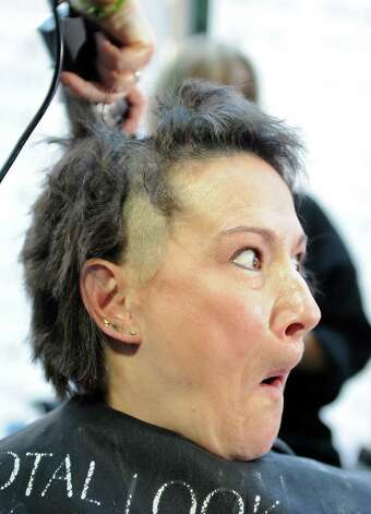 Debbie Crucitti reacts as her hair is  buzzed off during a 2010 St. Baldrick's fundraiser sponsored by TeamBrent in 2010. Photo: Autumn Driscoll, File Photo / Connecticut Post
