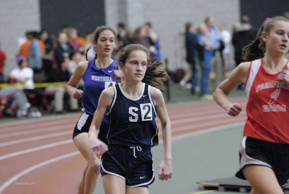 Staples High freshman Hannah DeBalsi, middle, competes in the FCIAC indoor track championships on Feb. 1 at Hillhouse High School in New Haven. DeBalsi finished second in the 3,200 (10:50.41) and third in the 1,600 (5:07.27). Photo by Keith Stein, StaplesRunning.com. Photo: Contributed Photo
