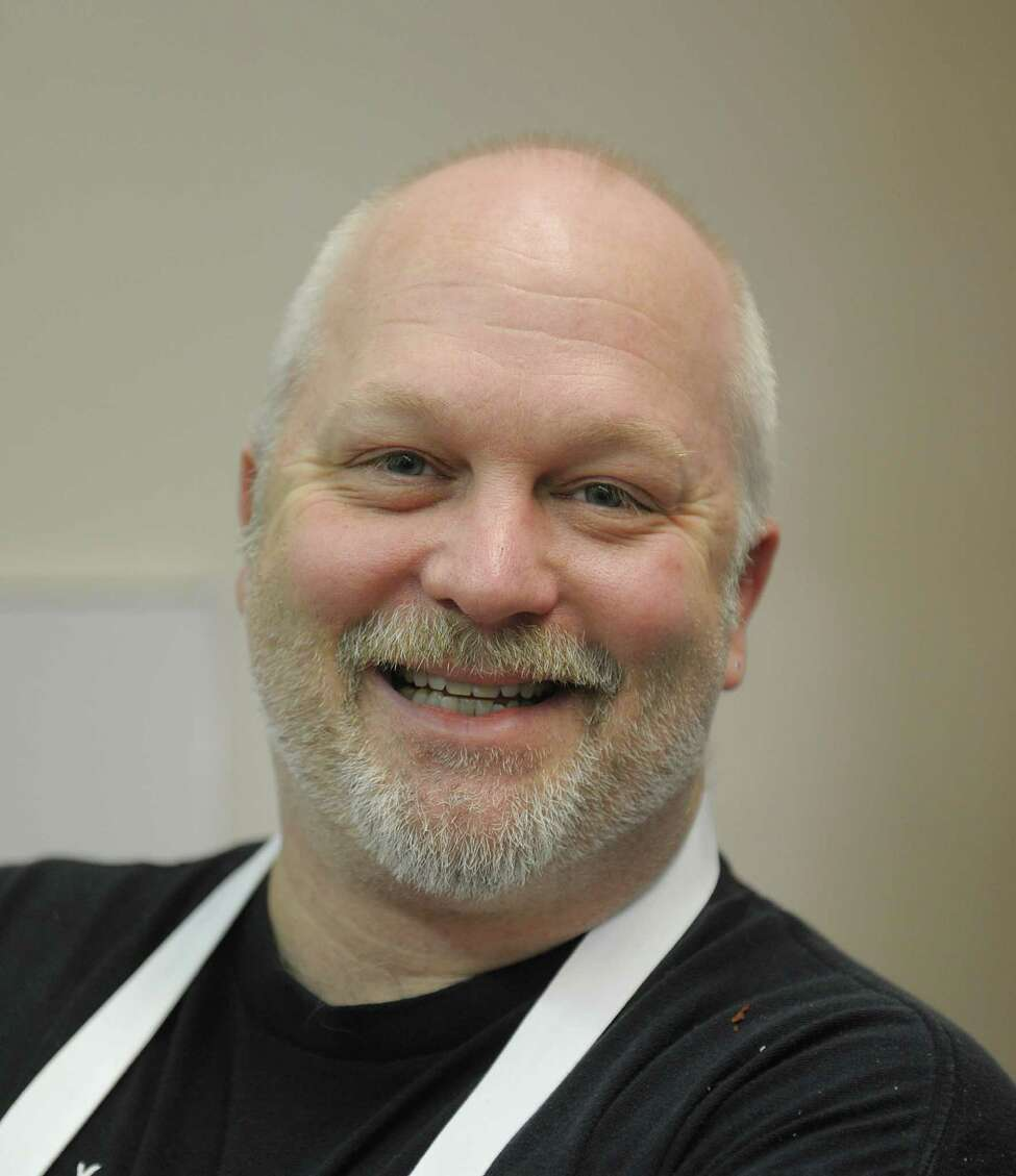Lyall MacFee, kitchen manager and chef at Sciortino's poses for a photograph at the restaurant on Monday, Feb. 18, 2013 in Albany, NY. (Paul Buckowski / Times Union)