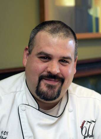 Ken Kehn, executive chef at 677 Prime poses for a photograph at the restaurant  on Monday, Feb. 18, 2013 in Albany, NY.   (Paul Buckowski / Times Union) Photo: Paul Buckowski