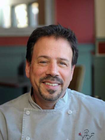 Carmine Sprio, owner and chef at Carmine's  poses for a photograph at the restaurant  on Monday, Feb. 18, 2013 in Albany, NY.   (Paul Buckowski / Times Union) Photo: Paul Buckowski