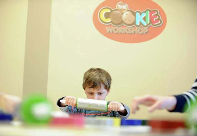 Four-year-old Jacob Weinstein, of Fairfield, rolls out dough during a cookie-making birthday party at The Cookie Workshop in Trumbull, Conn. Thursday, Feb. 21, 2013. Photo: Autumn Driscoll / Connecticut Post