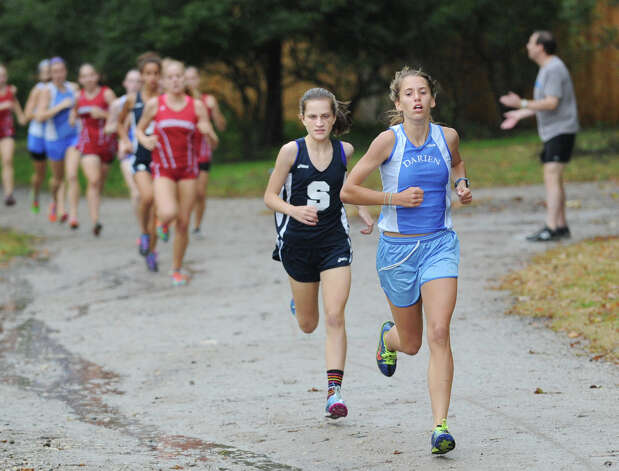 At right, Anne Johnston of Darien High School, the winner of the girls high school cross country meet, competes in the race held at Greenwich Point, Tuesday afternoon, Oct. 2, 2012. At center of photo is Hannah Debalsi of Staples who came in second. Photo: Bob Luckey / Greenwich Time