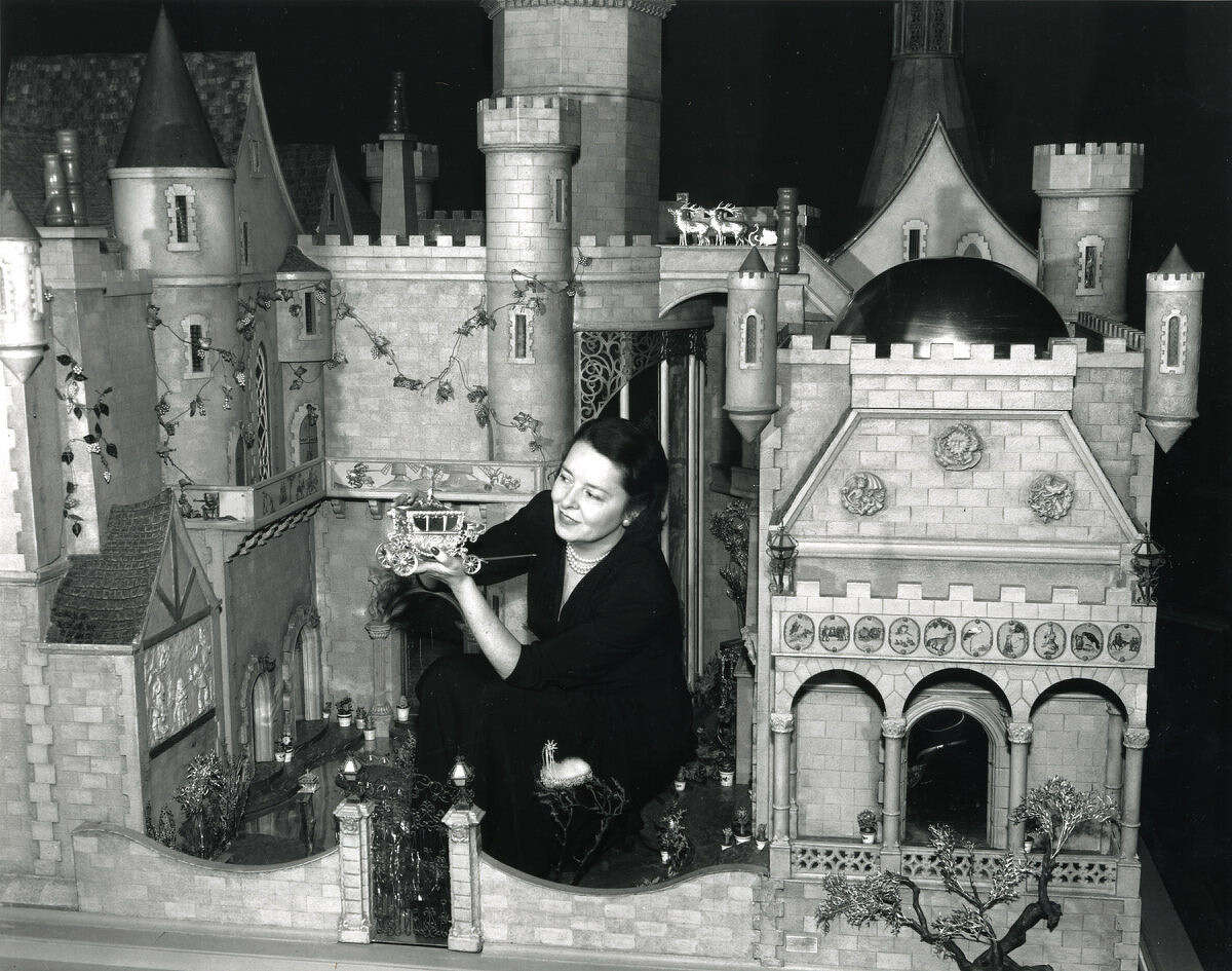 Silent-film star Colleen Moore shows off her $435,000 custom-built dollhouse, which she exhibited for several years in the 1930s to benefit children's charities.