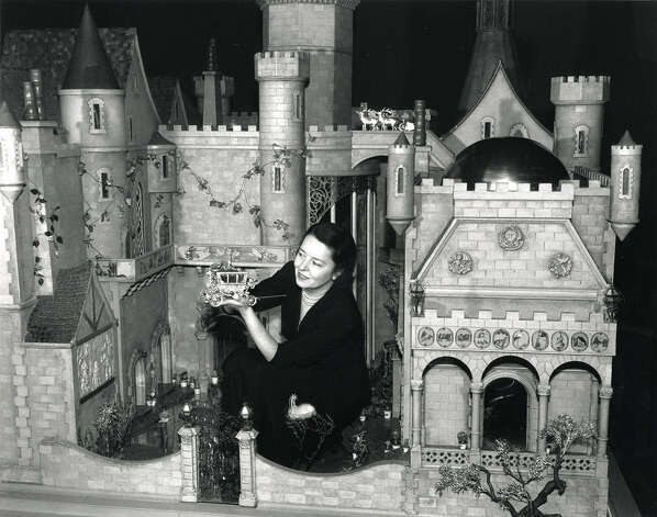 Silent-film star Colleen Moore shows off her $435,000 custom-built dollhouse, which she exhibited for several years in the 1930s to benefit children's charities. Photo: Courtesy Museum Of Science And Industry