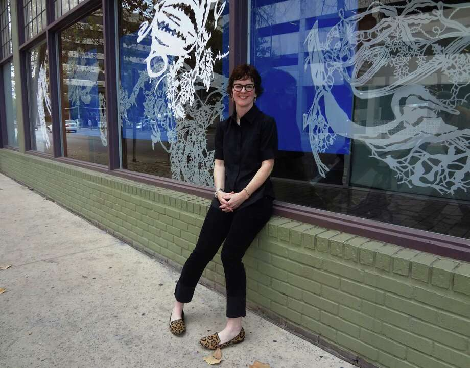 """Leigh Anne Lester created the botanical cutout work """"Cultivated Diversions"""" for Artpace's Window Works program. Photo: Steve Bennett / San Antonio Express-News"""