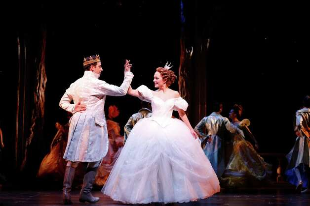 "Santino Fontana and Laura Osnes perform as Prince Charming and Cinderella in the first Broadway production of Rodgers and Hammerstein's ""Cinderella,"" which begins its regular performance schedule Tuesday, Feb. 26. Opening night is March 3, 2013. Cinderella's glass slipper was designed by Stuart Weitzman, a Greenwich resident who has been designing women's shoes for more than 25 years. The famed designer's work is well-known on the red carpet, where his bejeweled creations are often on display. Contributed photo/Carol Rosegg Photo: Contributed Photo"