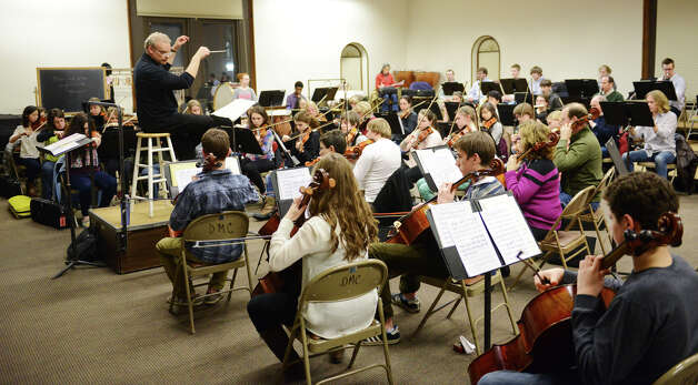 Members of the Danbury Community Orchestra, led by music director Stephen Smith, rehearse at the Danbury Music Centre in Danbury, Conn. Wednesday, Feb. 20, 2013. Photo: Tyler Sizemore / The News-Times