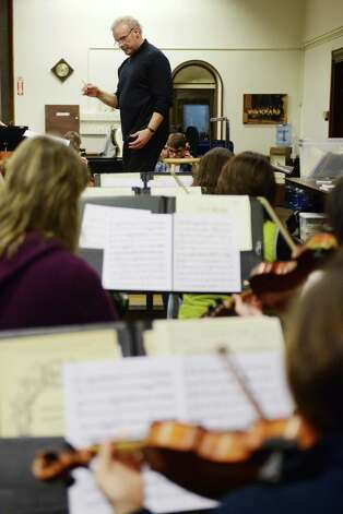 Music director Stephen Smith conducts the Danbury Community Orchestra during rehearsal at the Danbury Music Centre in Danbury, Conn. Wednesday, Feb. 20, 2013. Photo: Tyler Sizemore / The News-Times