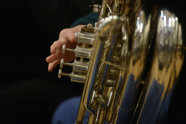 John Gaiser, of New Milford, Conn., plays the tuba during the Danbury Community Orchestra rehearsal at the Danbury Music Centre in Danbury, Conn. Wednesday, Feb. 20, 2013. Photo: Tyler Sizemore / The News-Times