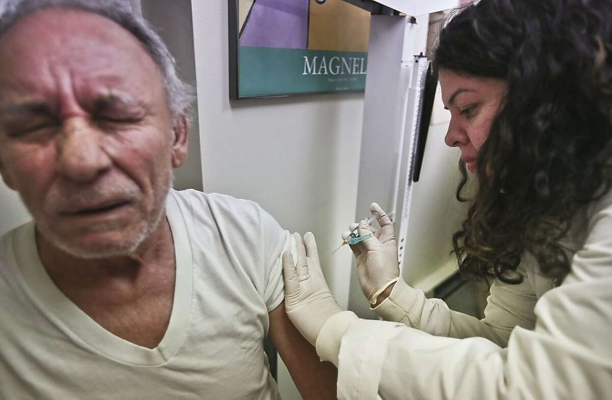 FILE - In this Tuesday, Jan. 15, 2013 file photo, Carlos Maisonet, 73, reacts as Dr. Eva Berrios-Colon, a professor at Touro College of Pharmacy, injects him with flu vaccine during a visit to the faculty practice center at Brooklyn Hospital in New York. Health officials said Thursday, Feb. 21, 2013 this season's flu shot was only 9 percent effective in protecting seniors against the most common and dangerous flu bug. Flu vaccine tends to protect younger people better than older ones and is never 100 percent effective. But experts say the preliminary results are disappointing and highlight the need for a better vaccine. (AP Photo/Bebeto Matthews, File)