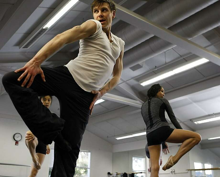 Diablo Ballet choreographer Robert Dekkers works with dancers Hiromi Yamazaki (left) and Mayo Sugano in rehearsals. Photo: Sean Havey, The Chronicle
