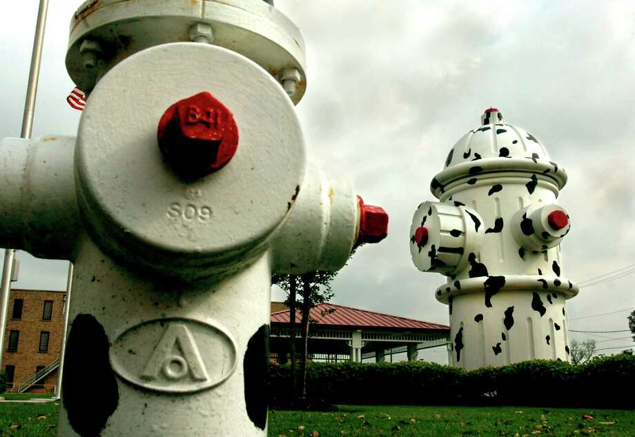 The 24 foot fire hydrant in front of the Fire Museum is a popular photo stop for tourists visiting the Beaumont area. The world's largest Dalmation spotted fire hydrant will be the scene of a dedication ceremony for a sculpture in honor of fallen firefighters by Ron Pettit on Saturday. Tammy McKinley/The Enterprise Photo: TAMMY MCKINLEY / Beaumont
