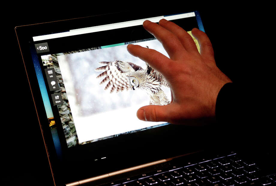 A man uses the touchscreen of the Google Chromebook Pixel laptop computer at an announcement in San Francisco, Thursday, Feb. 21, 2013. (AP Photo/Jeff Chiu) Photo: Jeff Chiu, Associated Press / AP