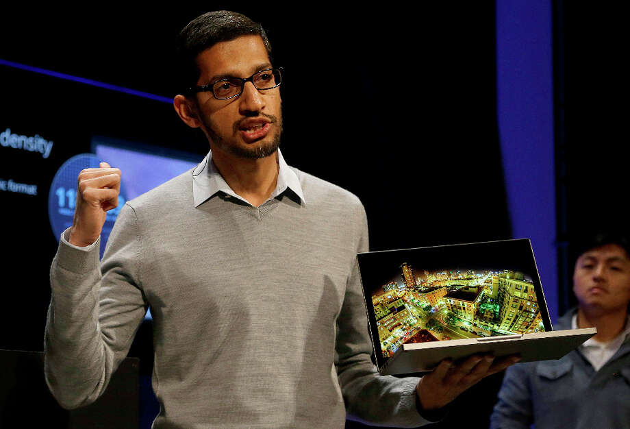 Sundar Pichai, Google's senior vice president of Chrome and apps, holds the Google Chromebook Pixel laptop computer at an announcement in San Francisco, Thursday, Feb. 21, 2013. (AP Photo/Jeff Chiu) Photo: Jeff Chiu, Associated Press / AP