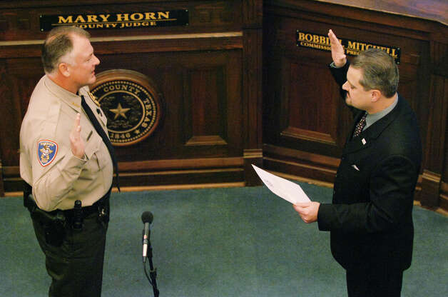 Newly elected Denton County Sheriff William Travis is sworn in by 431st District Judge Jonathan Bailey in the Commissioners Courtroom in the Courthouse on the Square, Tuesday, January 1, 2013, in Denton, TX. David Minton/DRC Photo: David Minton, Denton Record Chronicle DRC