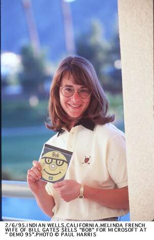 """Melinda French Gates in 1995 when she was an executive with Microsoft. She's showing a copy of """"Microsoft Bob"""" at the trade show """"Demo 95"""" in California. Photo: Paul Harris, Getty / Getty Images North America"""