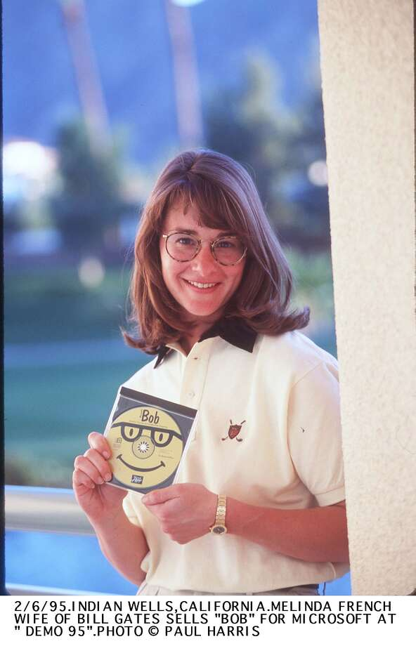 "Melinda French Gates in 1995 when she was an executive with Microsoft. She's showing a copy of ""Microsoft Bob"" at the trade show ""Demo 95"" in California. Photo: Paul Harris, Getty / Getty Images North America"