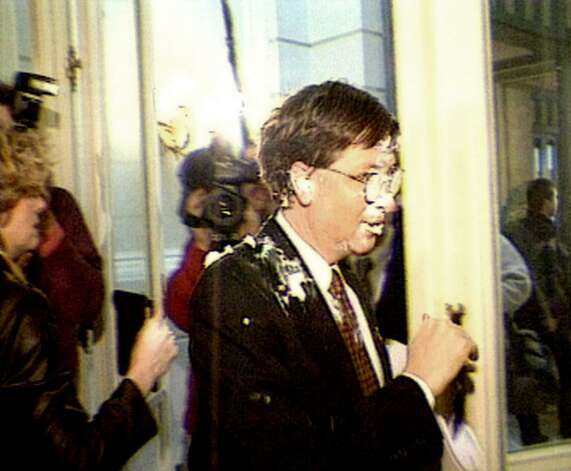 A video still of Gates walking past reporters after being hit by the infamous pie thrower, Noel Godin, in 1998 in Brussels, Belgium. Photo: Getty Images, Getty / Getty Images North America