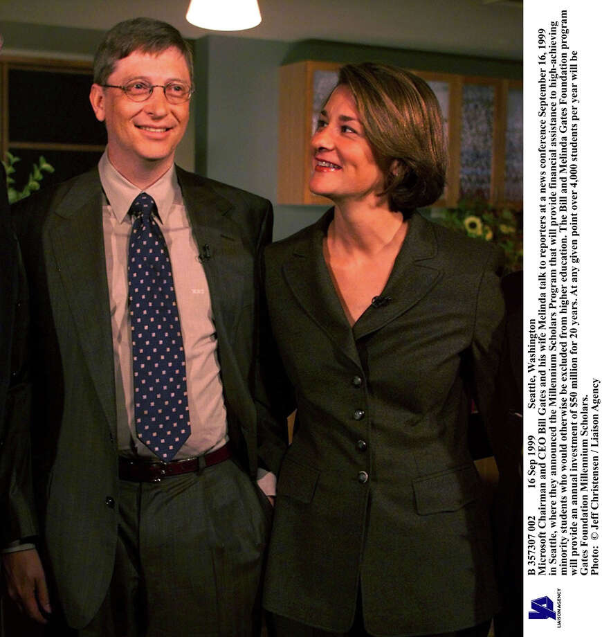 Bill and Melinda Gates talk at a news conference in 1999 in Seattle, where they announced the Millennium Scholars Program. Photo: Jeff Christensen, Getty / Getty Images North America