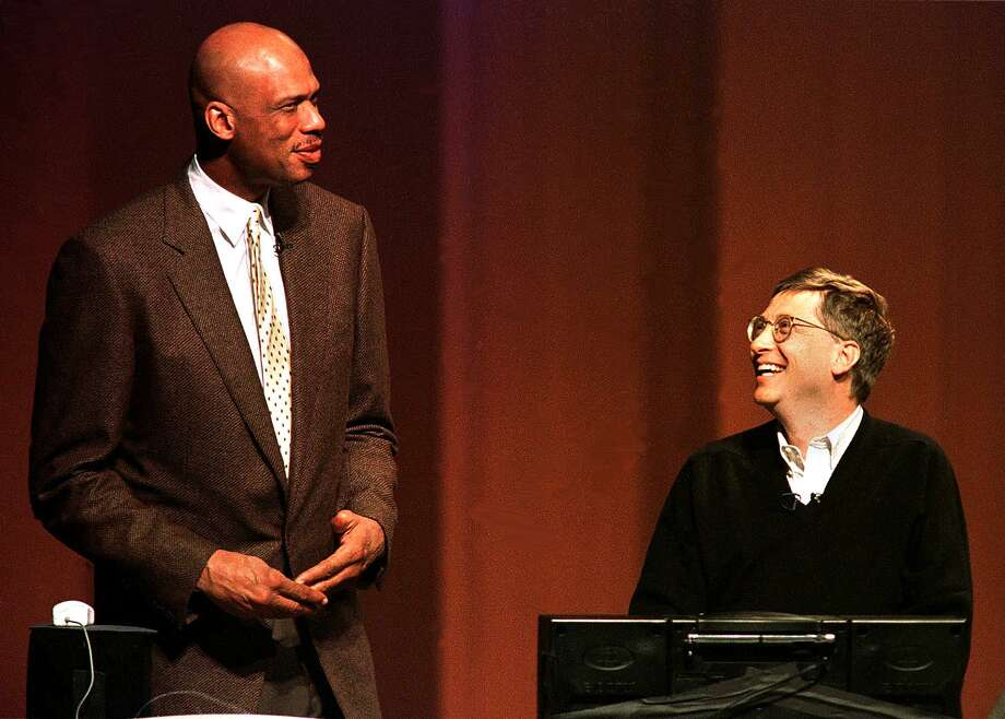 Gates and former NBA basketball star Kareem-Abdul Jabbar discuss Jabar's website during Gates' keynote speech to people attending the start of the COMDEX 97 convention at a hotel in Las Vegas. Photo: JOHN GURZINSKI, Getty / AFP