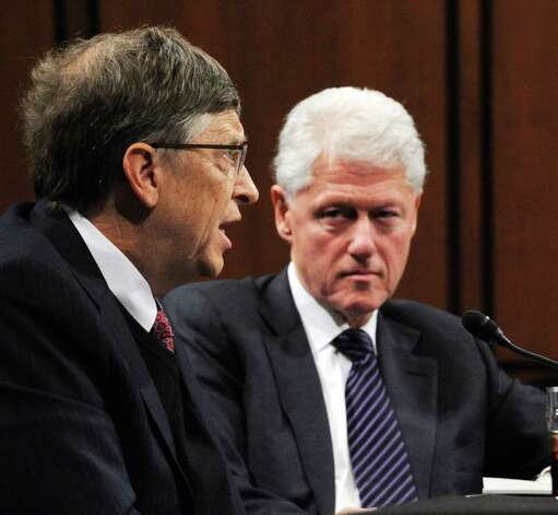 """Former US President Bill Clinton (R), chairman of the William J. Clinton Foundation and Bill Gates, co-chairman of the Bill and Melinda Gates Foundation testify before the Senate Foreign Relations Committee full committee hearing on """"Building on Success: New Directions in Global Health"""" on March 10, 2010 on Capitol Hill in Washington DC.    AFP PHOTO / Tim Sloan Photo: TIM SLOAN, Getty / 2010 AFP"""