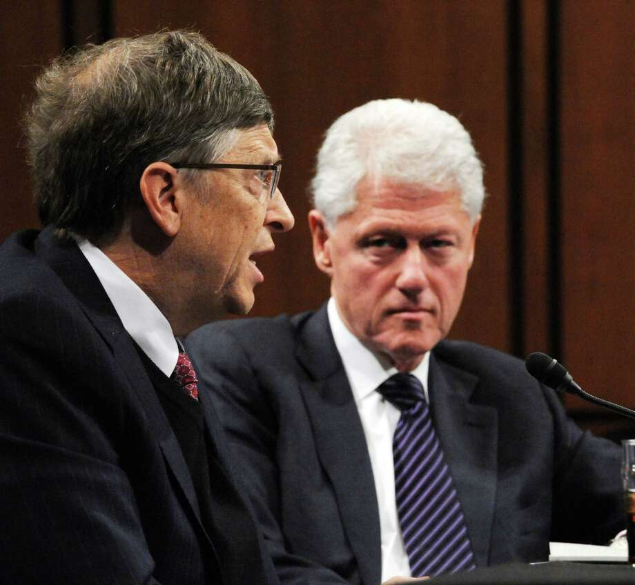"Former US President Bill Clinton (R), chairman of the William J. Clinton Foundation and Bill Gates, co-chairman of the Bill and Melinda Gates Foundation testify before the Senate Foreign Relations Committee full committee hearing on ""Building on Success: New Directions in Global Health"" on March 10, 2010 on Capitol Hill in Washington DC.    AFP PHOTO / Tim Sloan Photo: TIM SLOAN, Getty / 2010 AFP"