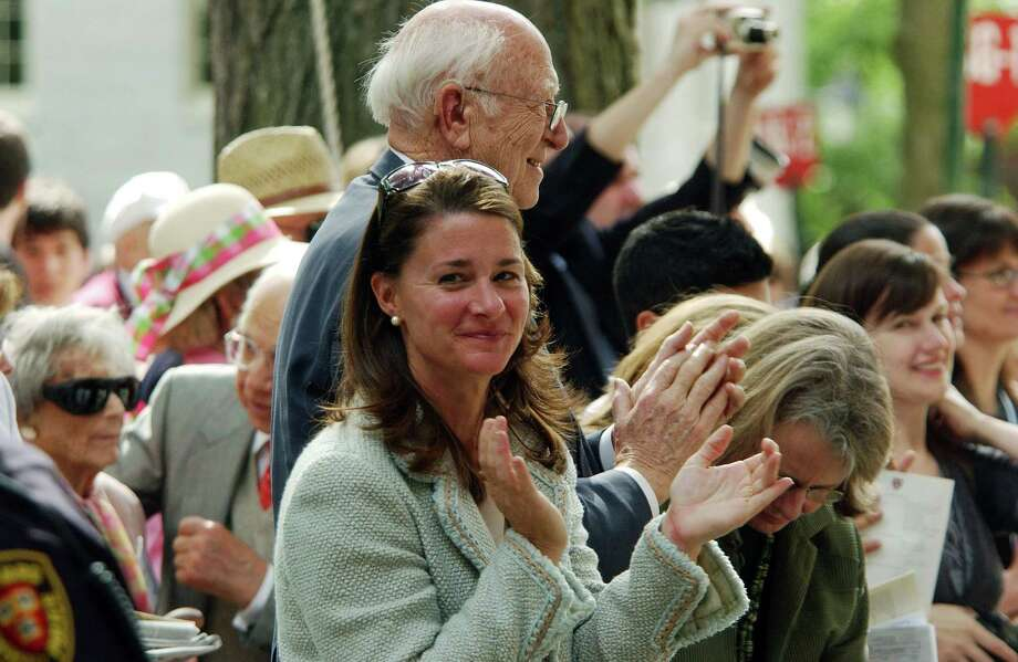 Melinda Gates and Bill Gates Sr. applaud as Microsoft co-founder and Chairman Bill Gates, gives the commencement speech at Harvard University in 2007 in Cambridge, Massachusetts. Gates, who enrolled at Harvard in a pre-law program in 1973 and left in his junior year, received an honorary Doctor of Laws degree earlier in the day. Photo: Darren McCollester, Getty / 2007 Getty Images