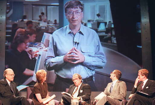 Gates appears on a large screen TV during a press conference with NBC in 1995 to launch the 24 hour NBC Microsoft television news channel. Photo: JON LEVY, Getty / AFP