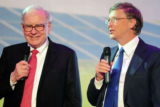 Leading US businessmen Warren Buffett (L) and Bill Gates (R) speak at the nationwide launch ceremony of Chinese electric vehicle BYD M6 in Beijing on September 29, 2010.    (AFP PHOTO/Frederic J. BROWN) Photo: FREDERIC J. BROWN, Getty / 2010 AFP