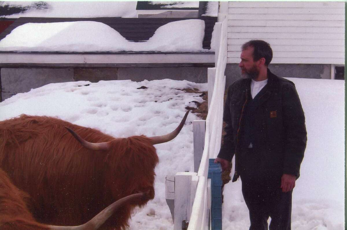 Photo courtesy Shakers Brother Arnold Hadd, one of the last three surviving Shakers, checks on beef cattle at the Sabbathday Lake Shaker community in Maine, the last remaining Shaker settlement.