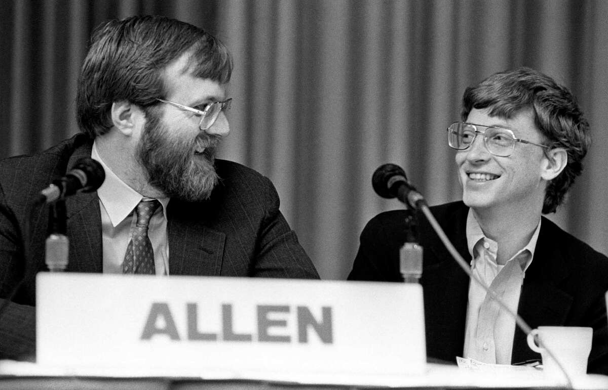 Paul Allen and Bill Gates share a laugh at the annual PC Forum, in Phoenix, Ariz, in 1987.