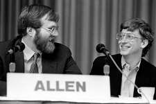 Paul Allen, from Asymetrix Corporation/Vulcan Inc., and Bill Gates, from Microsoft, share a laugh at the annual PC Forum, Phoenix, Arizona, February 22-25, 1987.