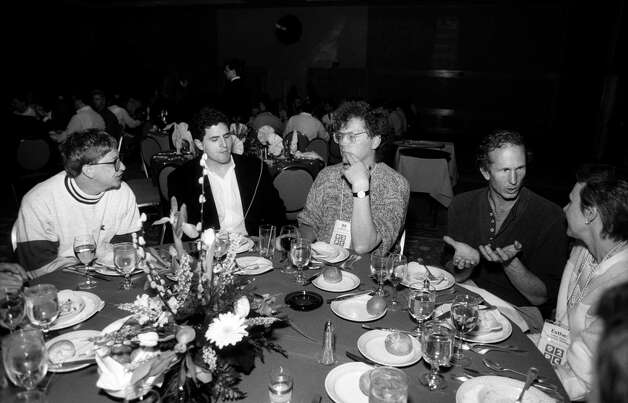 From left, Bill Gates, from Microsoft, Michael Dell, from Dell Computer, Bill Joy, from Sun Microsystem/Kleiner Perkins Caufield & Byers, Doyne Farmer, from Prediction Company/Santa Fe Institute, and Esther Dyson, from EDventure Holdings, sit together at a table during a dinner at the annual PC Forum, Tucson, Arizona, 1992. Photo: Ann Yow-Dyson/Getty Images, Getty / Photo by Ann Yow-Dyson, all rights reserved