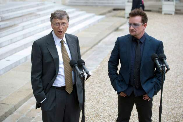 Irish musician and humanitarian activist Bono and Gates speak to the press after a meeting with French President at the Elysee Palace in 2012 in Paris.   (AFP PHOTO / LIONEL BONAVENTURE) Photo: LIONEL BONAVENTURE, Getty / 2012 AFP