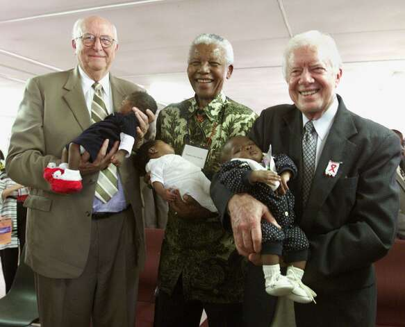 Bill Gates Sr., (L) former South African President Nelson Mandela and former U.S. President Jimmy Carter hold babies at the Zola clinic, in the Soweto Township outside of Johannesburg, South Africa, in 2002. The babies were born to mothers who tested positive for HIV. Bill Gates Sr. traveled in Africa with President Carter on a trip for the Bill and Melinda Gates Foundation.    (AFP PHOTO  Jeff Christensen) Photo: Getty
