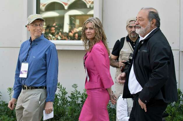 Mexican tycoon Carlos Slim, Bill Gates and the Chairwoman of the Governing Board of the International Maize and Wheat Improvement Center walk during the inauguration of the center, which was built with funds from their foundations, in Texcoco, Mexico State, on Feb. 13, 2013. (AFP PHOTO/Ronaldo Schemidt) Photo: AFP, Getty / 2013 AFP