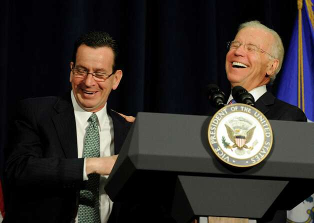 Gov. Dannel Malloy, left, speaking before the arrival of the vice president, told the audience that Biden would probably mention his grandparents in his remarks. Sure enough, within minutes, Biden brought up his grandfather to the amusement of the Governor and audience. Vice President Joe Biden was at Western Connecticut State University Thursday, Feb. 21, 2012, addressing a conference on gun violence. Photo: Carol Kaliff / The News-Times